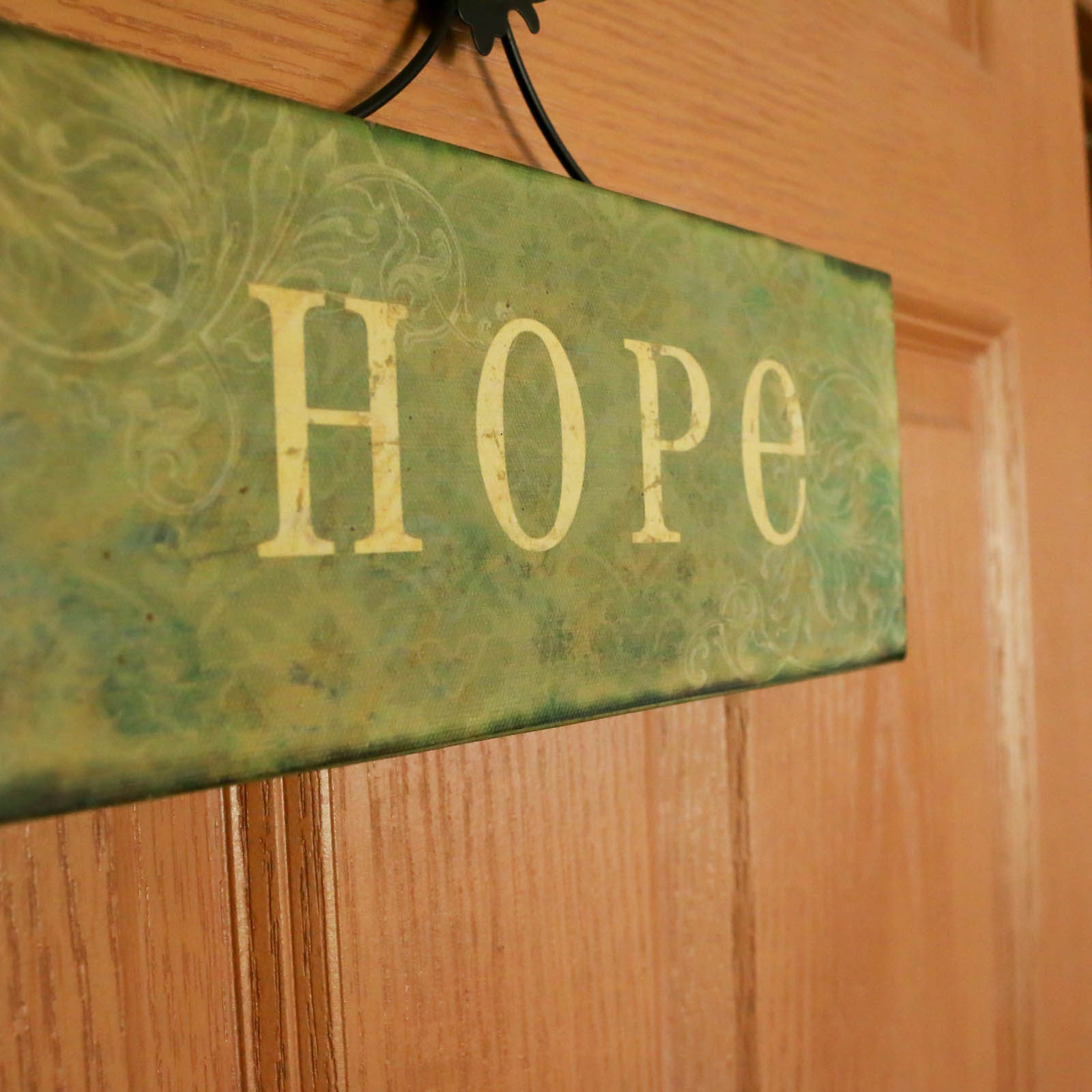 """""""Hope"""" sign hung on an office door in Waterloo location."""